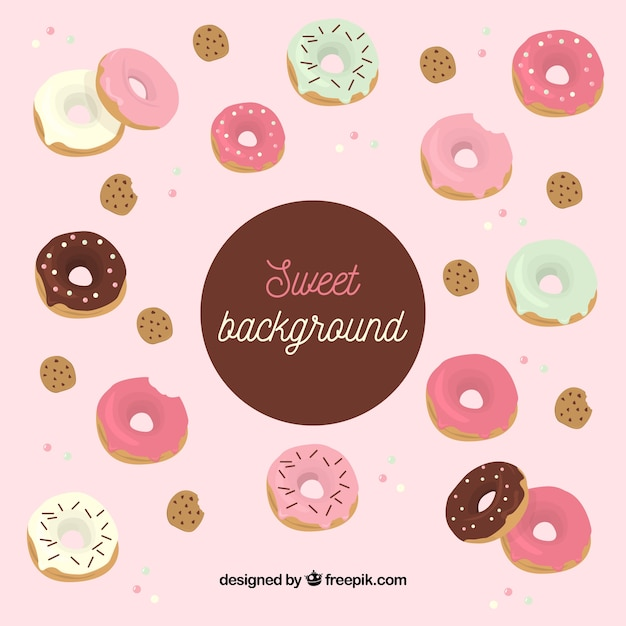 Food background with delicious donuts Free Vector