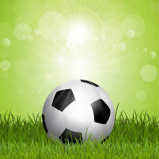 پس زمینه فوتبال با توپ فوتبال در چمن