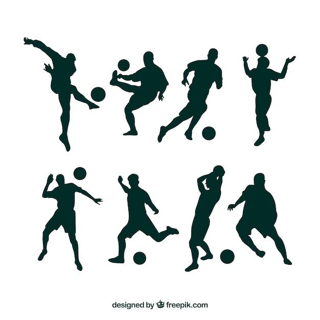 Футболисты силуэты в разных позициях Premium векторы