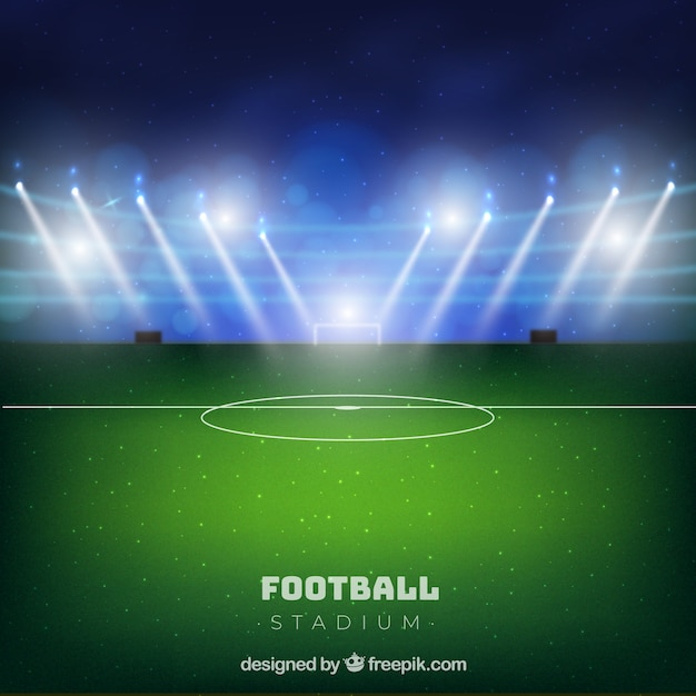 Football stadium in realistic style Free Vector