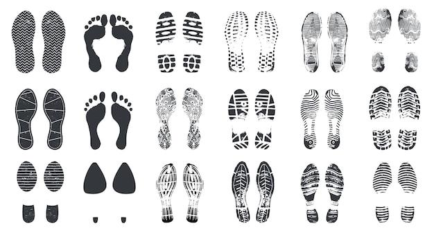 Силуэты следа. босиком, кроссовки и ступени обуви с текстурой грязи. идущие следы загрузки, изолированные набор векторных отпечатков ног Premium векторы
