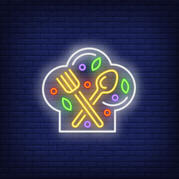 Fork, spoon and ingredients on chief hat neon sign Free Vector