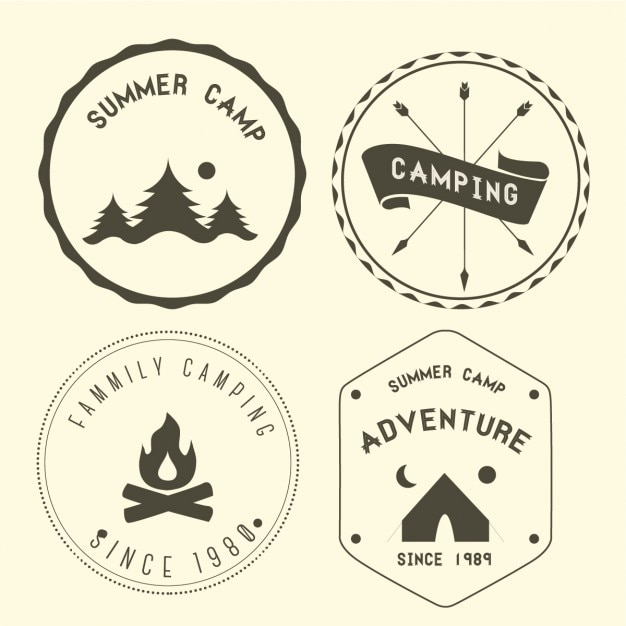 Four camping badges