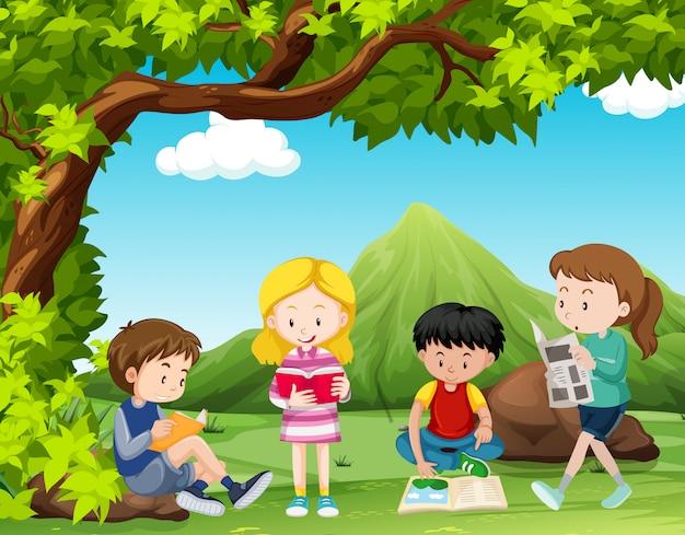 Four kids reading books under the tree Premium Vector