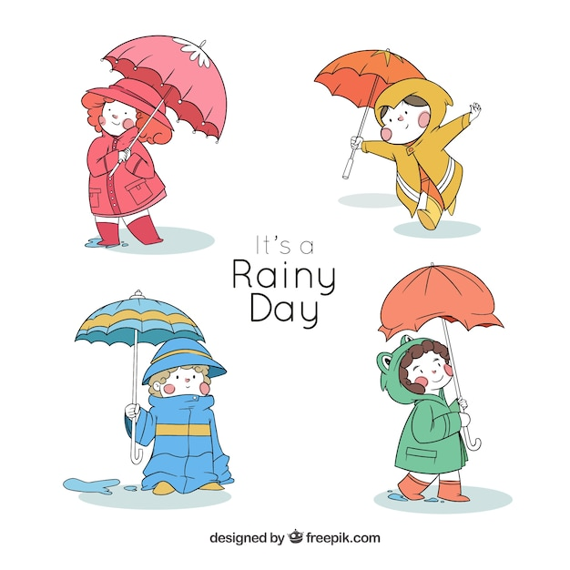 Four lovely kids with hand drawn umbrella Free Vector