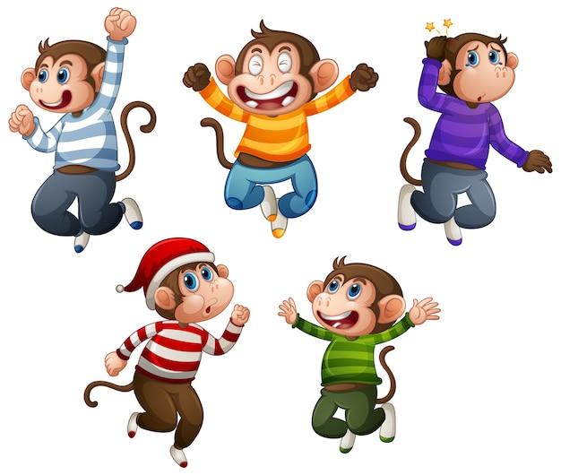 Четыре обезьяны в футболке в прыжковой позе, изолированные на белом фоне Бесплатные векторы