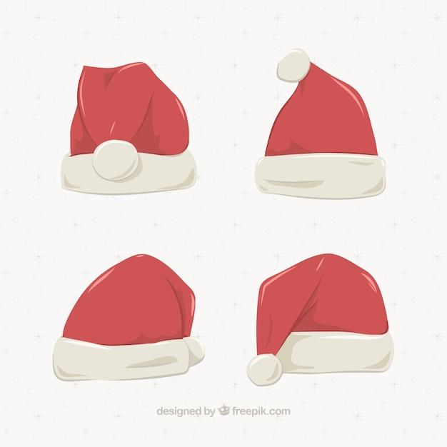 Four santa claus hats Free Vector
