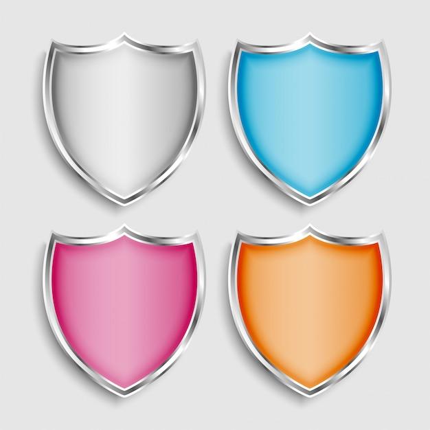 4 개의 빛나는 금속 방패 기호 또는 아이콘 설정 무료 벡터