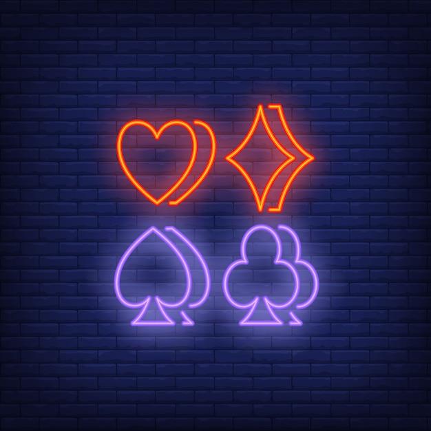 Four suit symbols neon sign Free Vector