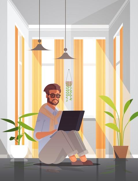 Freelancer using laptop man working from home self-isolation coronavirus pandemic quarantine concept Premium Vector