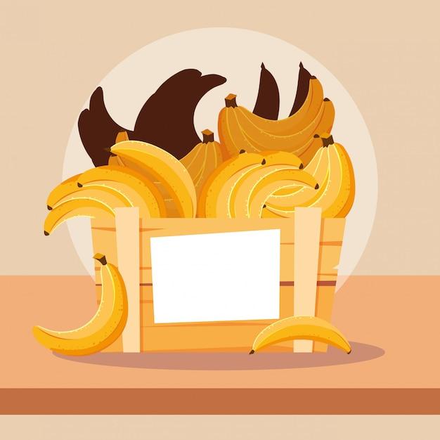 Fresh bananas fruits in wooden crate Premium Vector