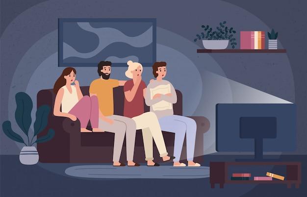 一緒にホラー映画を見ている友人。ソファの上に座って怖い十代の若者たちと暗いリビングルームのベクトル図で怖い映画を見る Premiumベクター