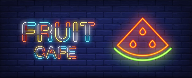 Fruit cafe neon sign. colorful text and slice of watermelon on brick wall background Free Vector