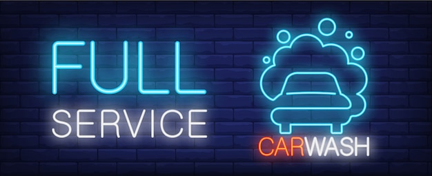 Full service car wash neon sign. vehicle in foam and luminous inscription on brick wall. Free Vector