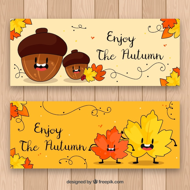 Fun autumn banners with hand drawnacorn and leaves Free Vector