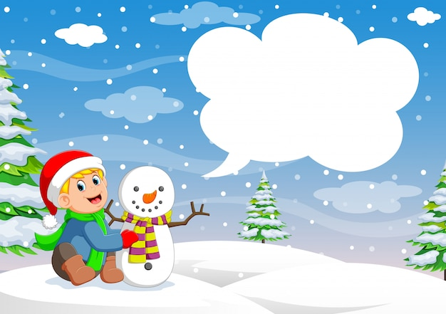 Funny little toddler boy in a red knitted nordic hat and warm coat playing with a snow Premium Vector