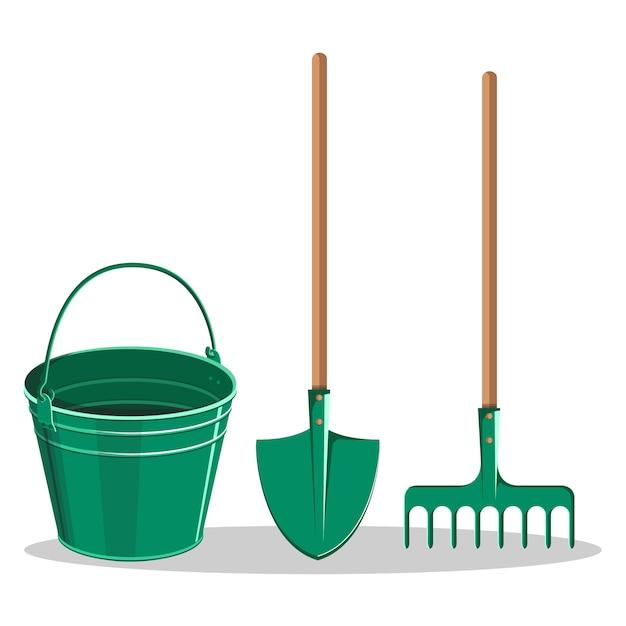 Gardening bucket, green shovel and rake on white Premium Vector