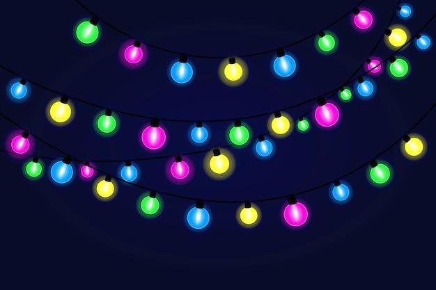 クリスマス、新年のバナー、カードのためのクリスマスのお祭りのライトの花輪。 Premiumベクター