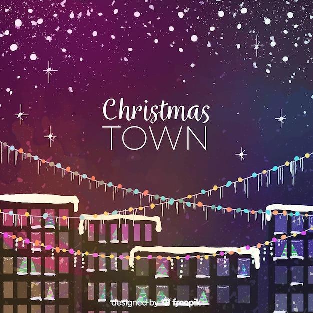 ライトgarlandsとクリスマスの町の背景 無料ベクター