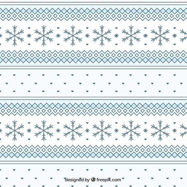 Geometric winter pattern with snowflakes Premium Vector
