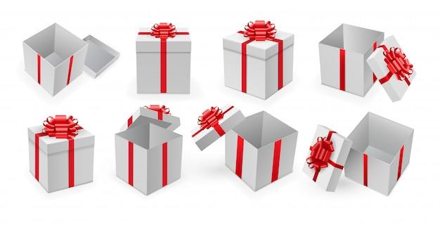 ギフト用の箱。赤いリボンと弓のベクトルでプレゼントボックスを開きます。驚きやギフトボックスが誕生日やクリスマスの休日の概念に設定。 Premiumベクター