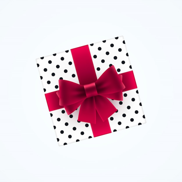 Gift box with red bow Premium Vector