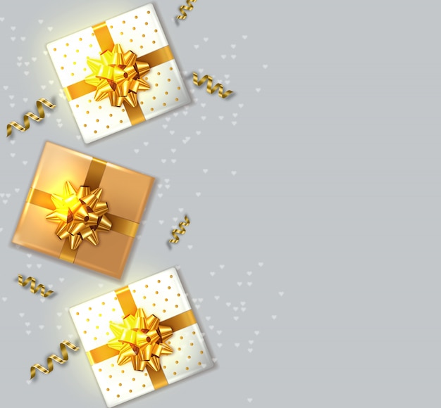 Gift boxes with golden bow Premium Vector