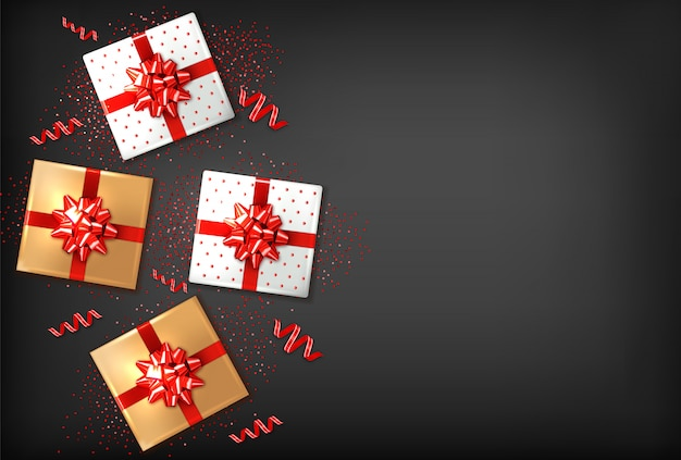 Gift boxes with red bow Premium Vector