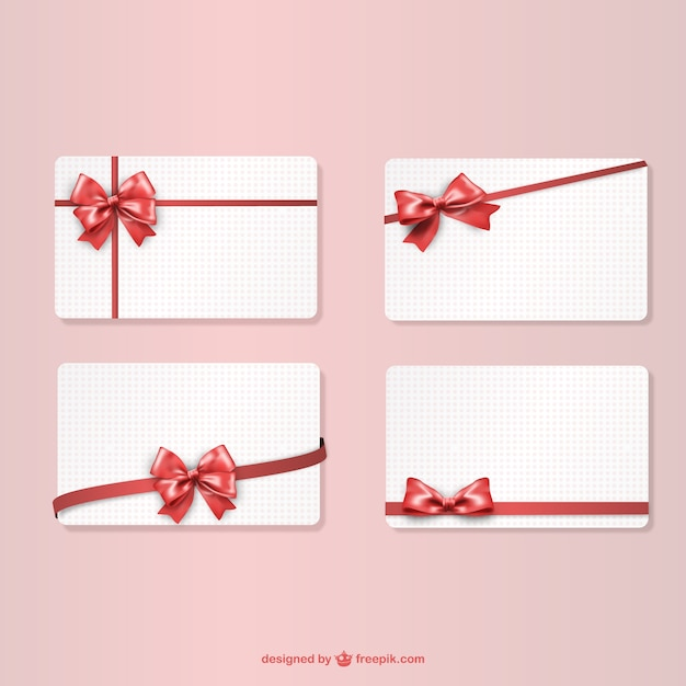 Gift cards with red ribbons Free Vector