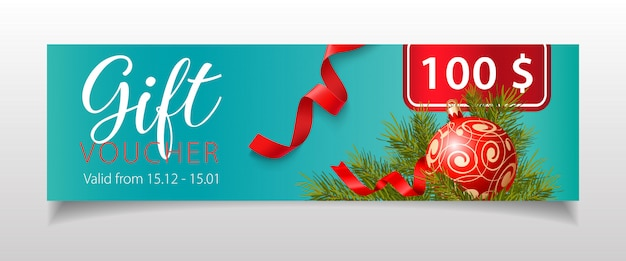 Gift voucher lettering with christmas bauble and fir-tree twigs Free Vector