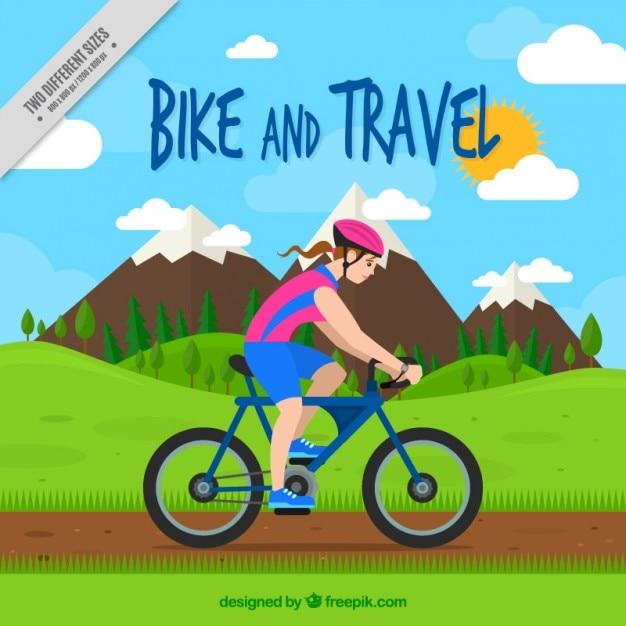 دوچرخه سوار دختر در پس زمینه چشم انداز