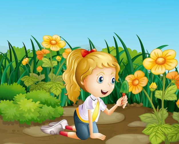 A girl in the garden holding a shovel Free Vector