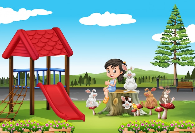 Girl and rabbits in the playground Free Vector