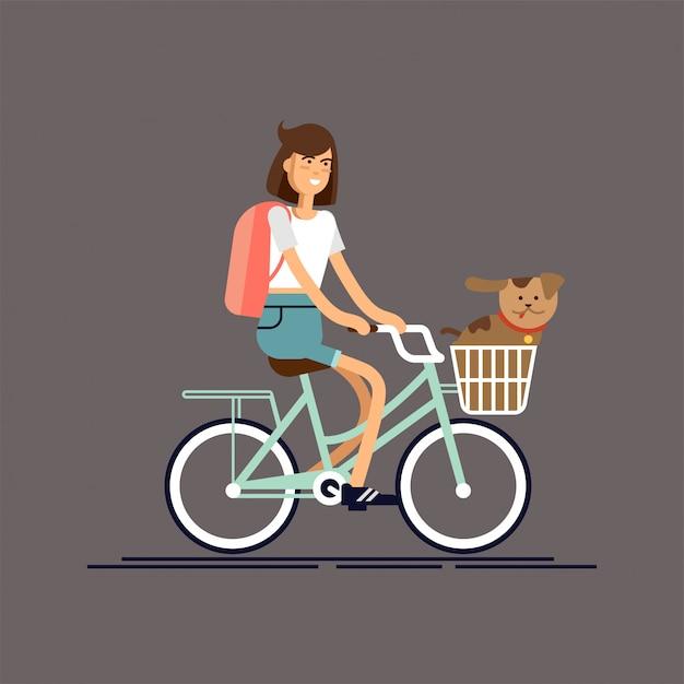 Girl rides bike with dog Premium Vector