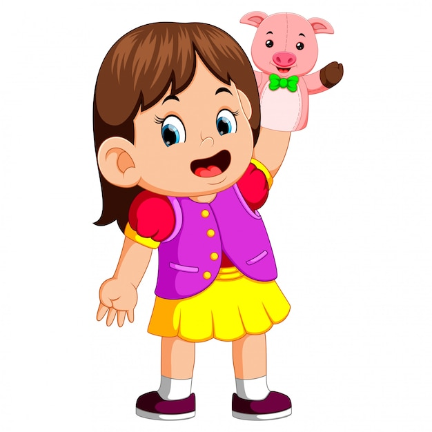 The girl was using cute pig puppet Premium Vector