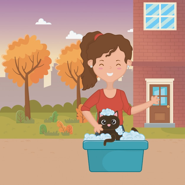 Girl with cat cartoon design Free Vector