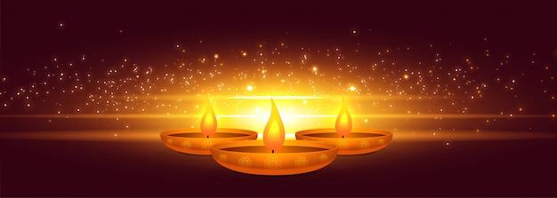 Glowing diwali diya with light sparkle banner Free Vector