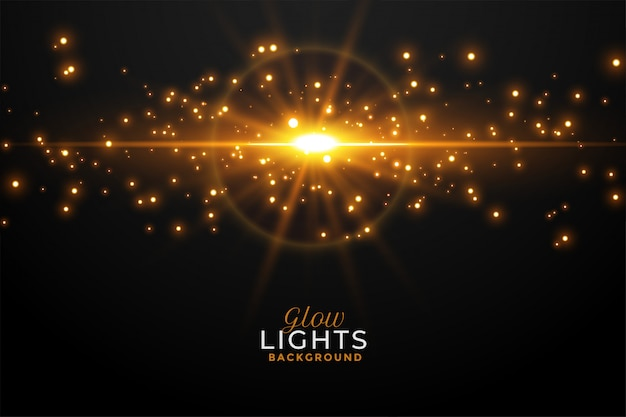Glowing golden light flare with sparkles background Free Vector
