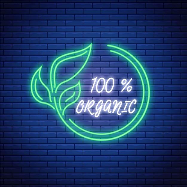 Светящийся неоновый 100% органический продукт. зеленый эко символ. логотип из натуральных продуктов в неоновом стиле Premium векторы
