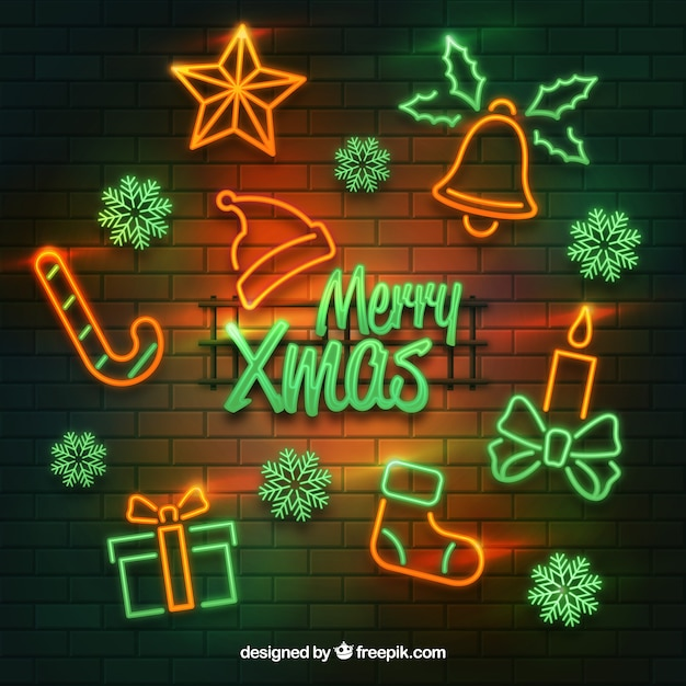 Glowing neon christmas elements on a brick wall background Free Vector