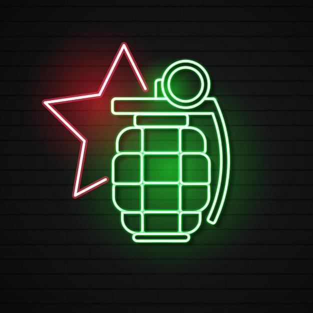 レンガ壁の背景に分離された輝くネオン手手榴弾アイコン。爆弾爆発。 Premiumベクター