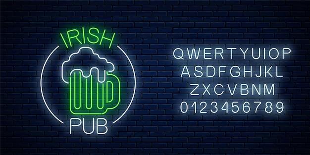 Glowing neon irish pub signboard in circle frame with alphabet on dark brick wall Premium Vector