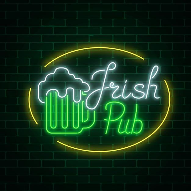 Glowing neon irish pub signboard in ellipse frame on dark brick wall background. luminous advertising sign Premium Vector