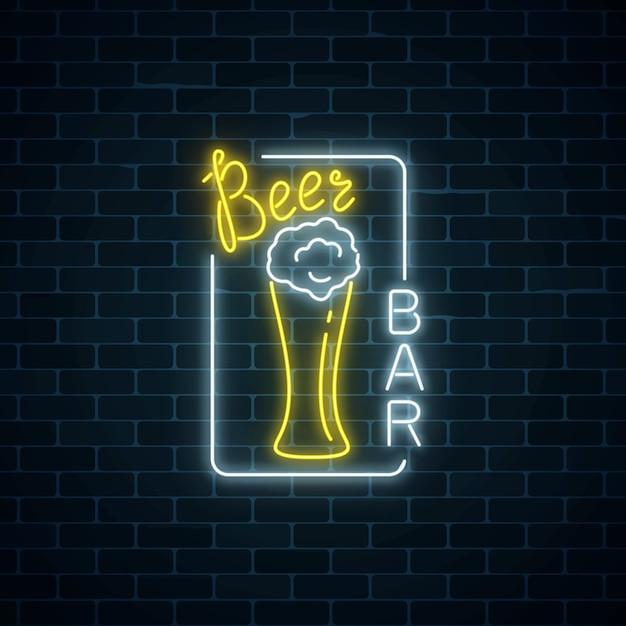 Glowing neon signboard of beer bar in rectangle frame on dark brick wall background. Premium Vector