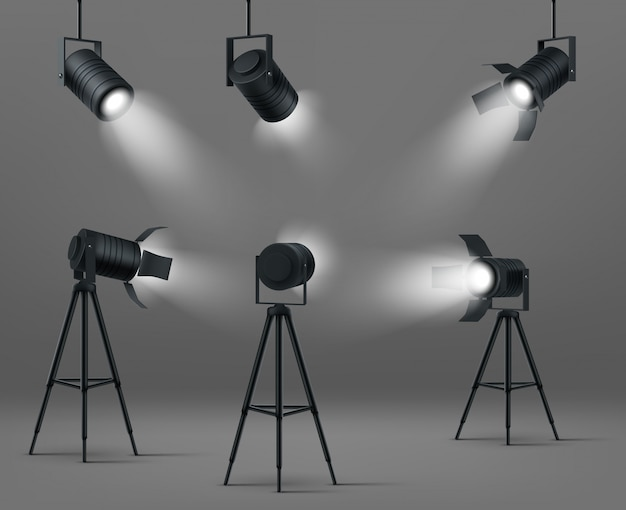 Glowing spotlights for studio or stage Free Vector