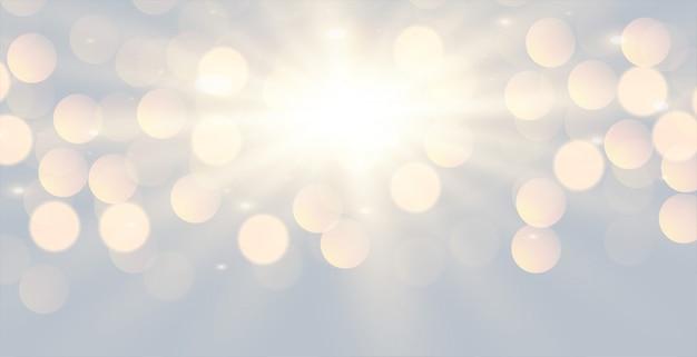 Disegno di sfondo effetto luce bokeh bianco incandescente Vettore gratuito