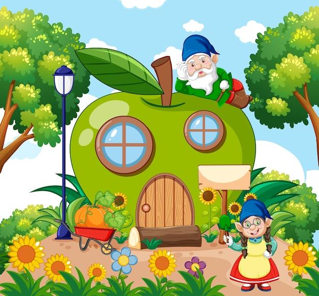 ノームと青リンゴの家と空の背景に庭の漫画のスタイルで Premiumベクター