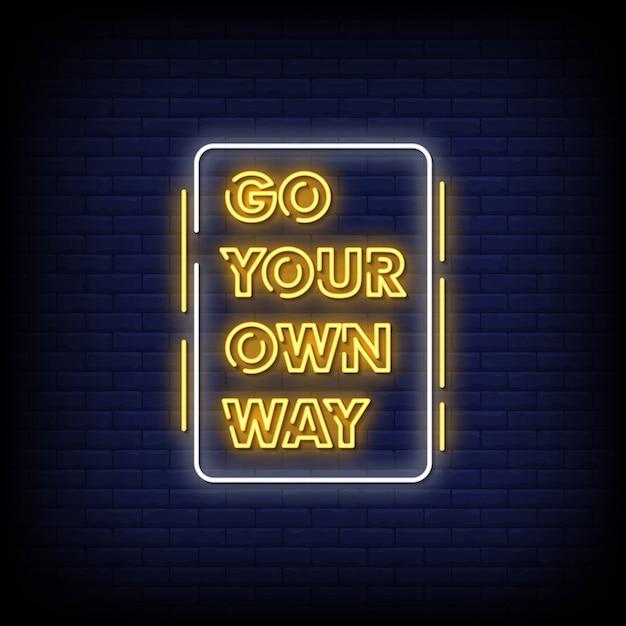 Go your own wayレンガの壁にネオン看板 Premiumベクター