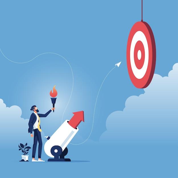 目標達成コンセプト-ビジネスマンが大砲を通してビジネスの矢を発射 Premiumベクター