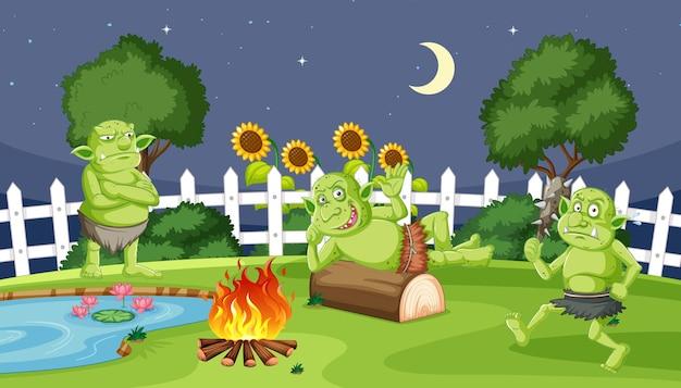 庭で漫画風のキャンプの夜のゴブリンやトロール 無料ベクター